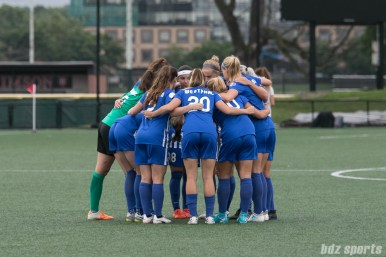 The Boston Breakers starting XI huddle before the start of the game.