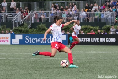 Chicago Red Stars forward Christen Press (23) sends in the ball from midfield.