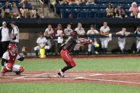Akron Racers outfielder Kristen Wycoff (11) bunts the ball.
