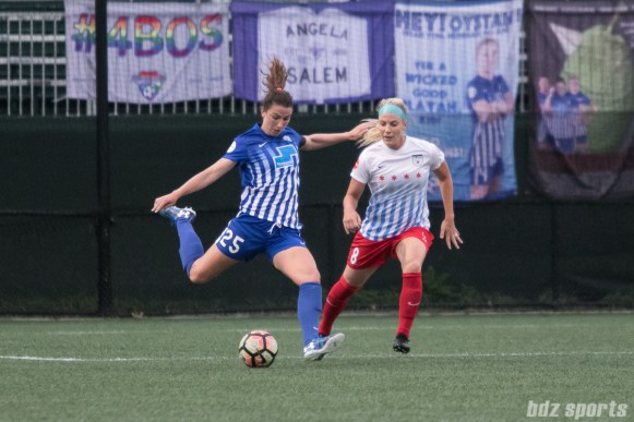 Boston Breakers midfielder Morgan Andrews (25) sends in a long ball whiel Chicago Red Stars defender Julie Ertz (8) looks on.