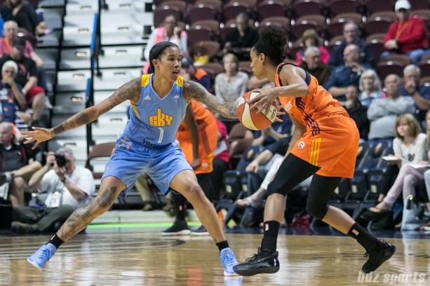Chicago Sky forward Tamera Young (1) defends against Connecticut Sun guard Jasmine Thomas (5).
