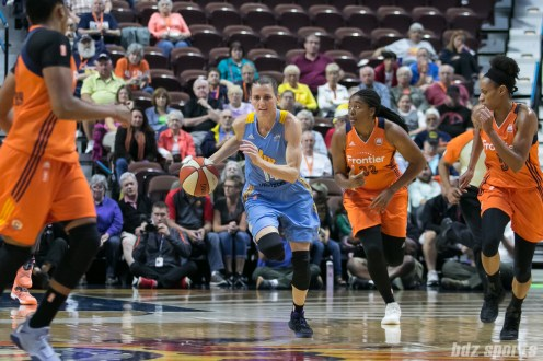 Chicago Sky guard Allie Quigley (14) dribbles the ball down the court.