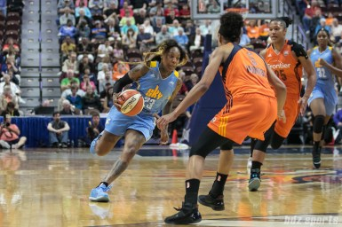 Chicago Sky guard Cappie Pondexter (23) looks to dribble past the Sun defense.