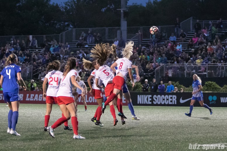 Chicago Red Stars defenders Katie Naughton (5) and Julie Ertz (8) look to head a ball out of danger.