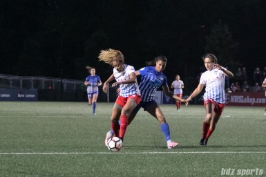 Chicago Red Stars defender Casey Short (6) steals the ball away from Boston Breakers forward Midge Purce (21).