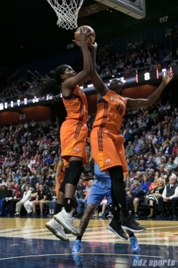 Connecticut Sun center Jonquel Jones (35) comes up with defensive rebound over teammate Shekinna Stricklen (40).