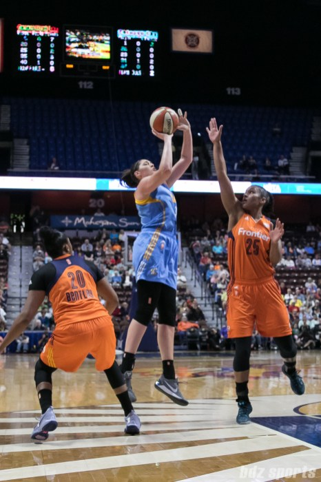 Chicago Sky center Stefanie Dolson (31) focuses on her shot while being defended by Connecticut Sun forward Alyssa Thomas (25).