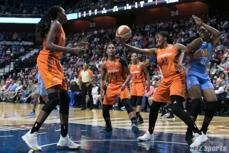 Connecticut Sun forward Morgan Tuck (33) boxes out Chicago Sky forward Cheyenne Parker (32) to come up with the rebound.