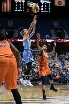 Chicago Sky guard Courtney Vandersloot (22) takes a shot over Connecticut Sun guard Jasmine Thomas (5).