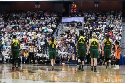 Seattle Storm players Jewell Loyd (24), Sue Bird (10), Ramu Tokashiki (7), Sami Whitcomb (3), and Breanna Stewart (30) prepare to resume play after a timeout.