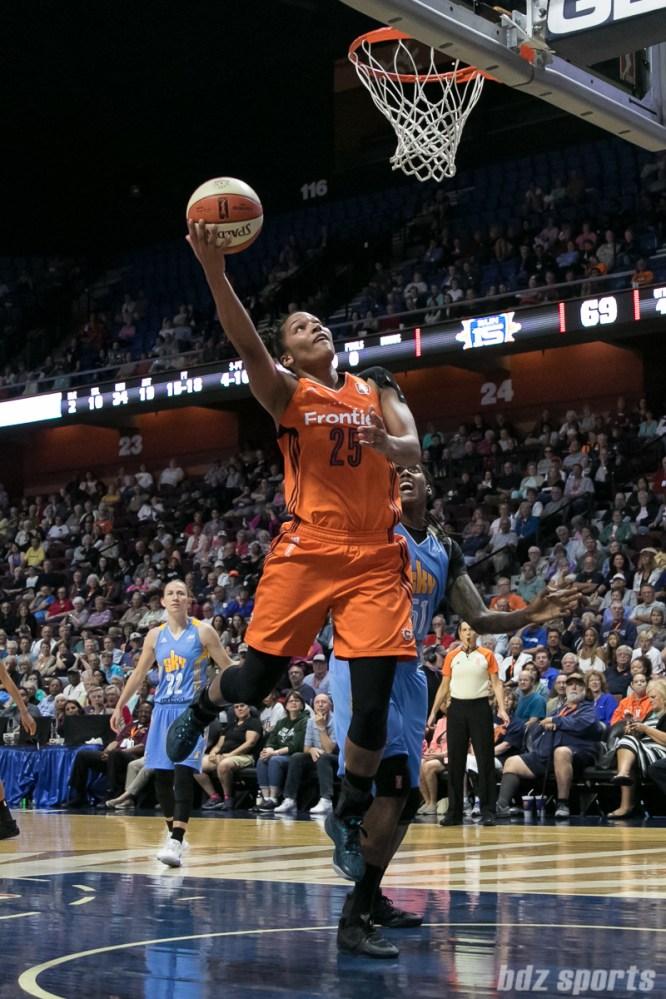 Connecticut Sun forward Alyssa Thomas (25) lays in a basket.