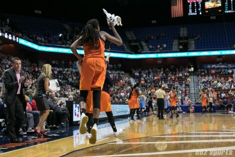 Connecticut Sun center Jonquel Jones (35) skips to greet teammates after the Chicago Sky call a timeout.