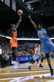 Connecticut Sun guard Courtney Williams (10) takes a shot over the outstretched arm of Chicago Sky forward Jessica Breland (51).