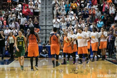 The Connecticut Sun celebrating their 96 - 89 win over the Seattle Storm.