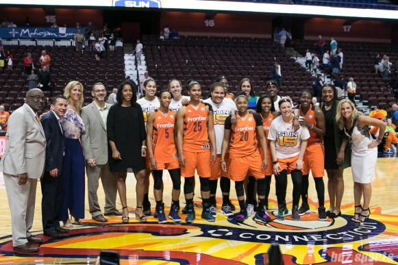 The Connecticut Sun team alongside past Sun players in celebration of the organization's 15 years in the WNBA.