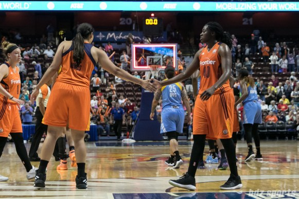 Connecticut Sun forwards Brionna Jones (42) and Shekinna Stricklen (40) shake hands after the Sun defeat the Chicago Sky 93-72.