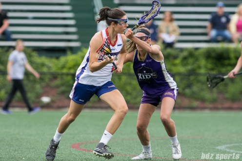 Long Island Sound midfielder Kaleigh Craig (21) takes on a Baltimore Ride defender.