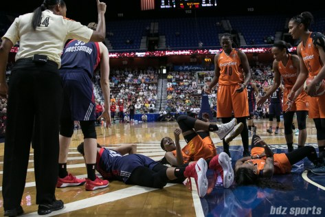 Connecticut Sun center Jonquel Jones (center on the ground) looks to the official to see what the call was.