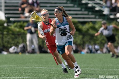 Philadelphia Force defender Katie Hersch (25) controls the ball for the Force.