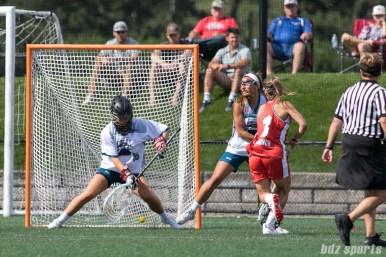 Boston Storm Kayla O'Connor (3) slips in a shot between the legs of Philadelphia Force goalie Zoe Ochoa (16).