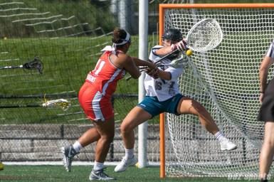 Boston Storm attacker Bre Hudgins (11) takes a shot on Philadelphia Force goalie Zoe Ochoa (16).