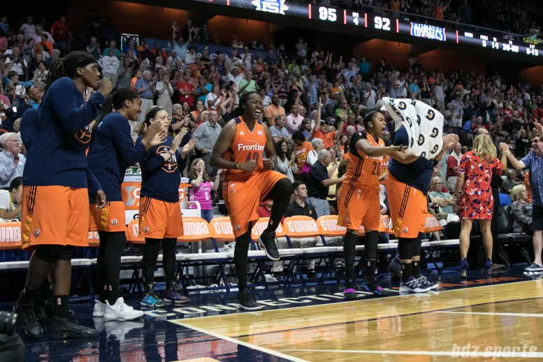 The Connecticut Sun bench celebrate after the team made a key defensive stand to maintain their 3 point lead as time on the clock wound down.