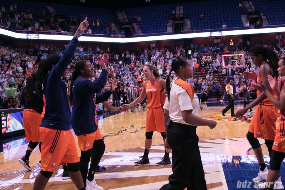 The Connecticut Sun celebrate their 96 - 92 win over the Washington Mystics.