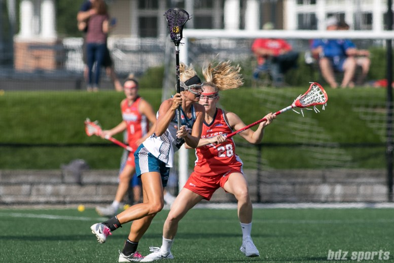 Boston Storm midfielder Kaila Gottlick (28) defends against a Philadelphia Force player.