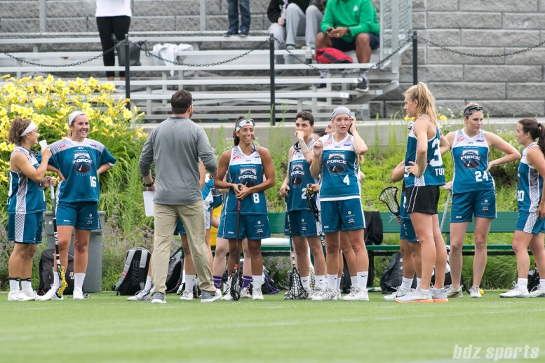The Philadelphia Force share a laugh prior to the start of the game.