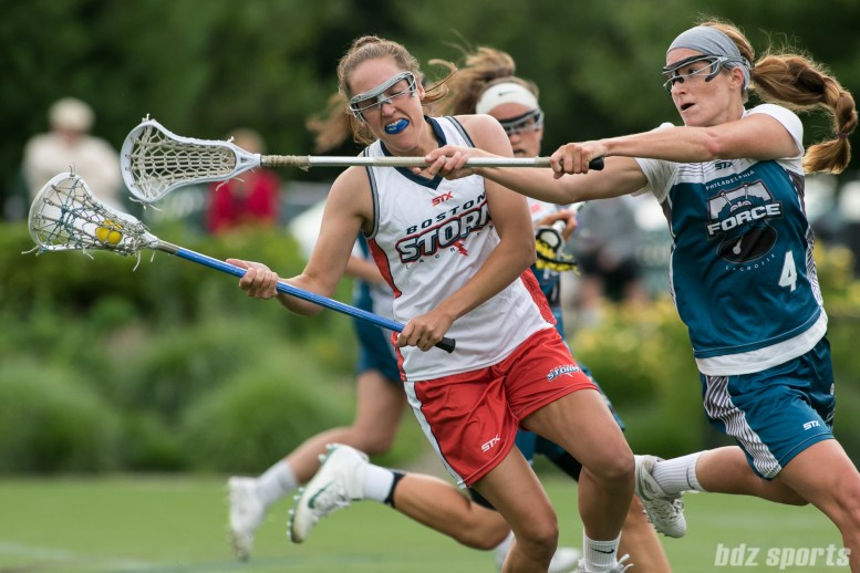 A Boston Storm player avoids the stick of Philadelphia Force Kelsey McGovern (4).