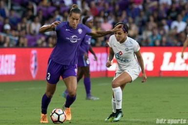 Orlando Pride defender Toni Pressley (3) maintains possession as FC Kansas City forward Sydney Leroux (14) looks on.