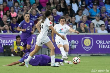Orlando Pride defender Camila Pereira (9) attempts to block a pass from FC Kansas City defender Christina Gibbons (31).