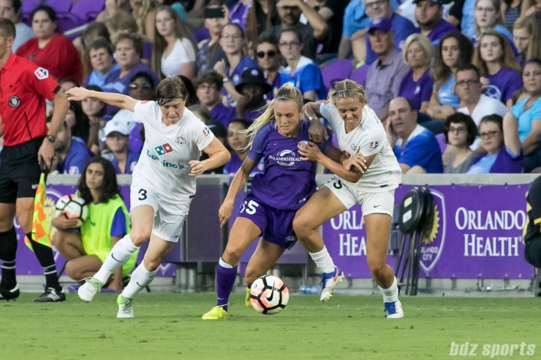 Orlando Pride forward Rachel Hill (15) looks to make her way past two FC Kansas City defenders.