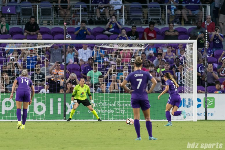 Orlando Pride forward Alex Morgan (13) takes a penalty kick against FC Kansas City goalkeeper Nicole Barnhart (18).