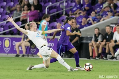 Orlando Pride forward Marta (10) makes her way past FC Kansas City defender Becky Sauerbrunn (4).