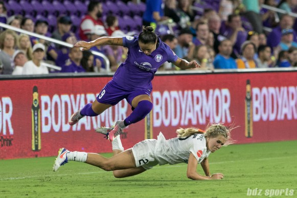 Orlando Pride defender Camila Pereira (9) leaps over FC Kansas City forward Brittany Ratcliffe (25).