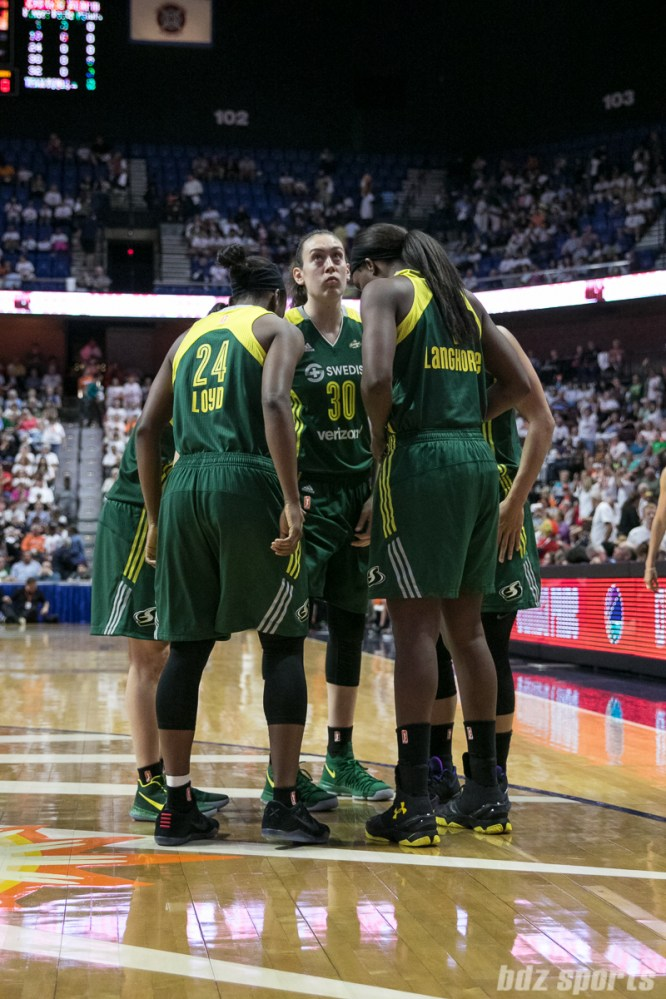 Seattle Storm Jewell Loyd (24), Breanna Stewart (30), and Crystal Langhorne (1) huddle as the starting five get ready for tip off.