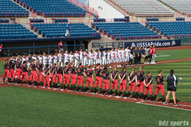 The Akron Racers and Beijing Eagles stand for the playing of the United States and Chinese national anthems.