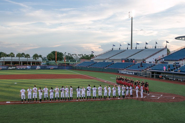 The USSSA Pride and Akron Racers line up for the playing of the national anthem before their game on July 16, 2017.