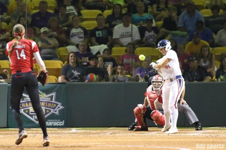 USSSA Pride infielder Lauren Chamberlain (44) gets hit by a pitch