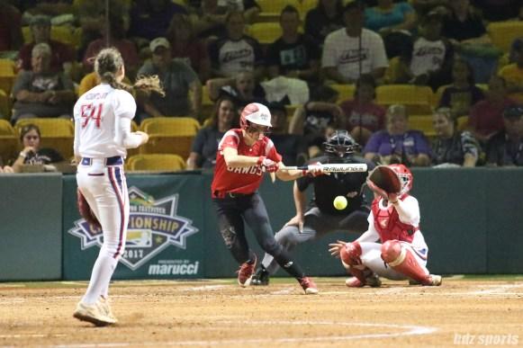 Scrap Yard Dawgs first baseman Britt Vonk (18) lays down abunt