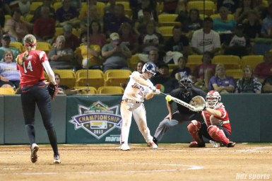 USSSA Pride outfielder Megan Wiggins (25) makes contact with the ball