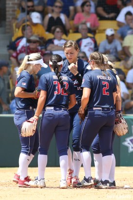 The USSSA Pride infielders huddle together at the mound