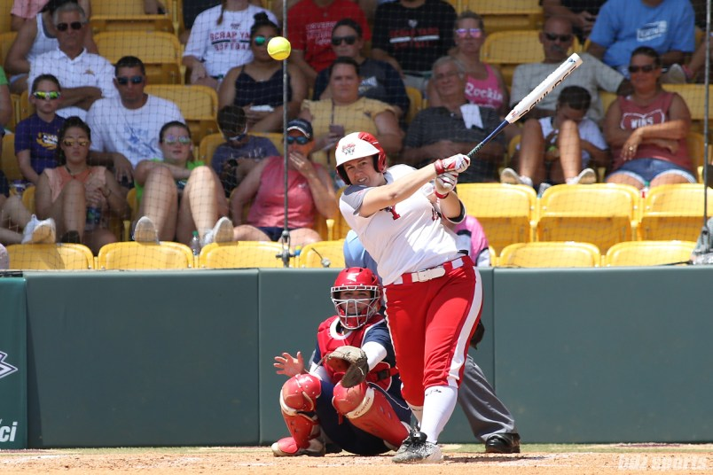 Scrap Yard Dawgs designated hitter Meagan May Whitley (13) hits the ball down the center