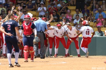 Scrap Yard Dawgs outfielder Nerissa Myers (15) is greeted by teammates after hitting a home run in the bottom of the 4th inning