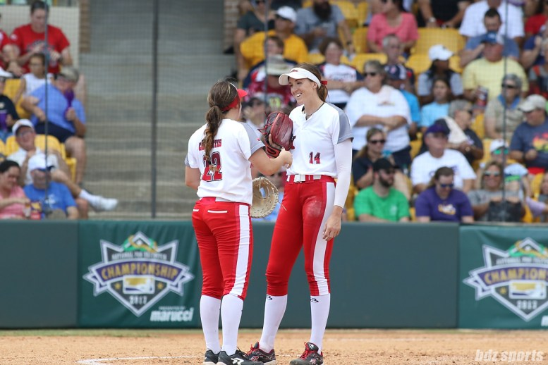 Scrap Yard Dawgs first baseman Brittany Cervantes (22) and pitcher Monica Abbott (14) share a quick chat at the mound