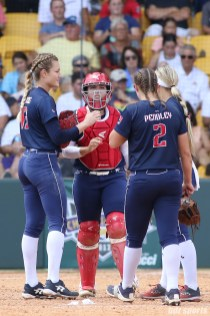 The USSSA Pride infielders huddle at the mound