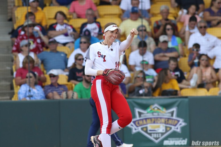 Scrap Yard Dawgs pitcher Monica Abbott (14) sends an air fist bump to right fielder Kayla Winkfield (not pictured)