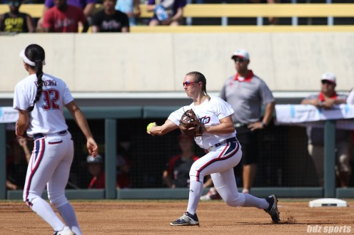 USSSA Pride shortstop Shelby Pendley (2) makes a throw to first base