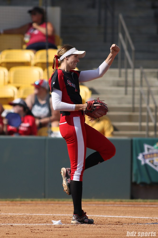 Scrap Yard Dawgs pitcher Monica Abbott (14) sends a fist pump out to right field before the start of the bottom of the inning